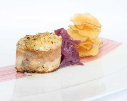 Filet of sword wrapped in bacon-crusted lemon and almonds on onion and potato petals